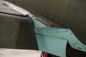 Port flap and wing root